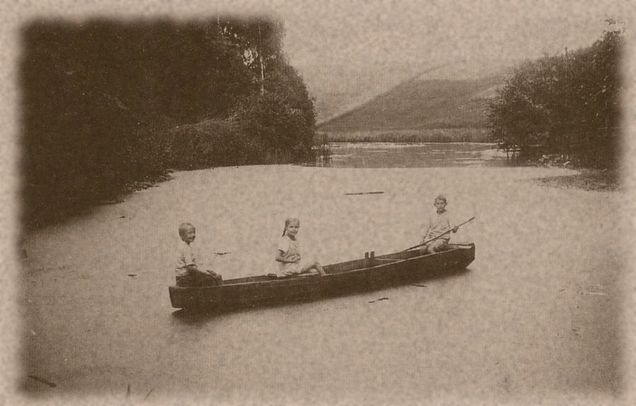 Children in the boat on the mill pond